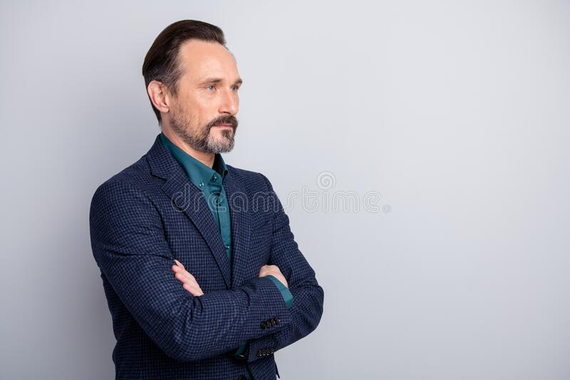 Profile side view portrait of his he nice attractive content middle age man in old-fashioned formalwear folded arms. Profile side view portrait of his he nice stock images