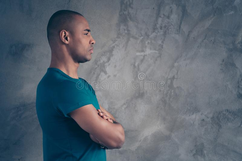 Profile side view portrait of his he nice-looking attractive strong character feature content guy wearing trendy blue t. Shirt isolated over gray industrial stock photos