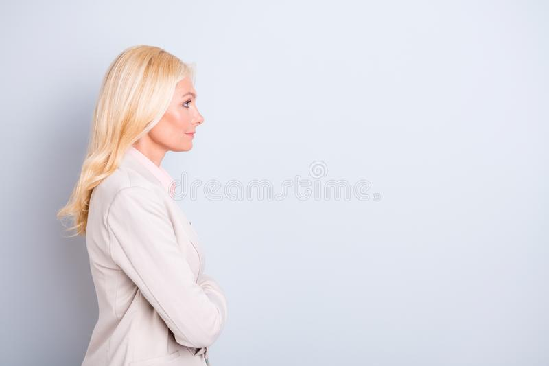 Profile side view portrait of nice attractive kind lovely peaceful calm wavy-haired lady copy empty blank space isolated. Profile side view portrait of nice stock photo