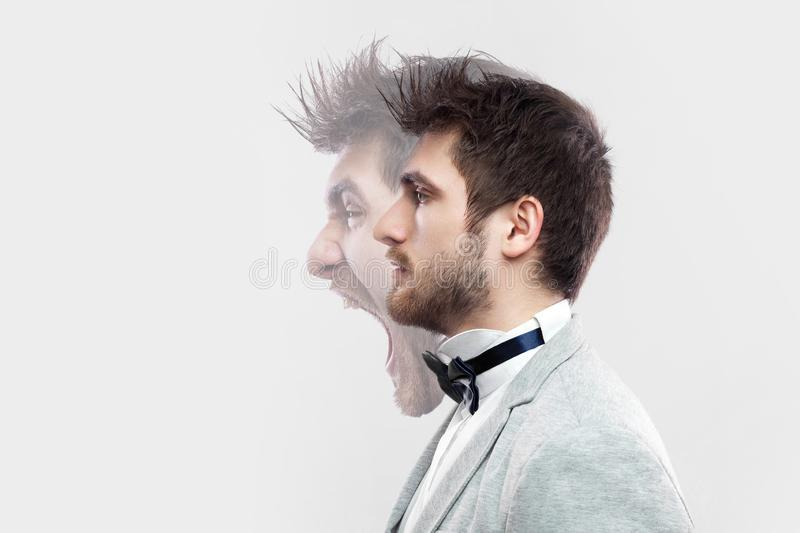 Profile side view portrait of two faced young man in calm serious and angry screaming expression. different emotion inside and stock photos