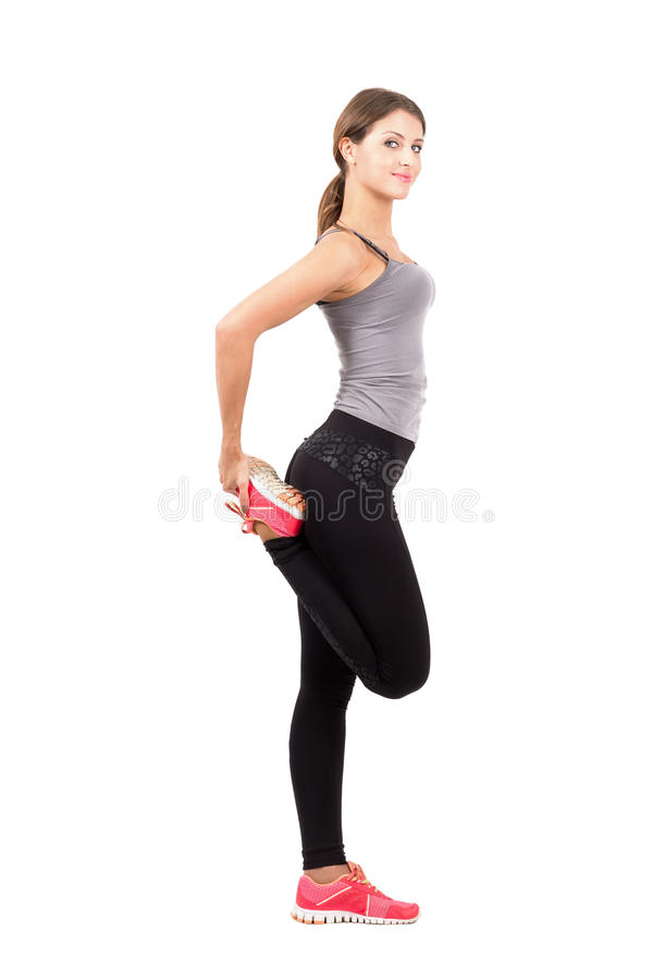 Profile side view of young sporty female beauty stretching leg royalty free stock images