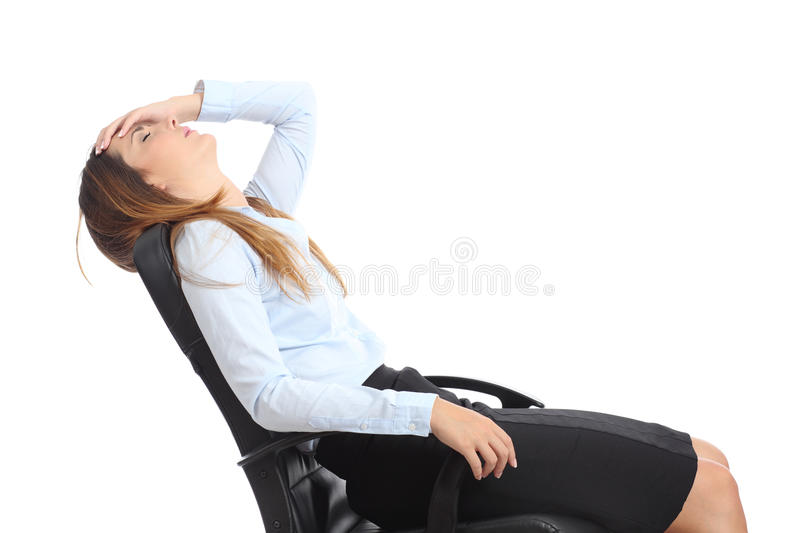 Profile of a tired businesswoman sitting on a chair stock photo