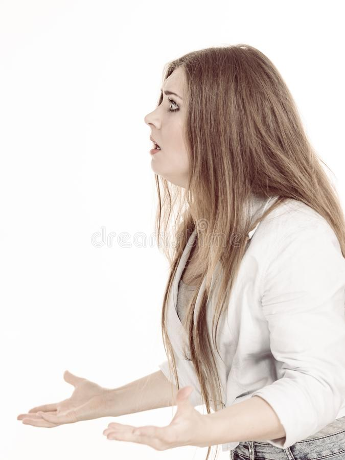 Profile view of angry woman. Being off. Very frustrated lady yelling at someone stock photography