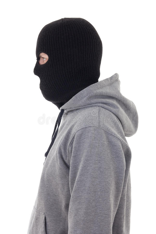 Profile view of criminal man in mask isolated on white stock images