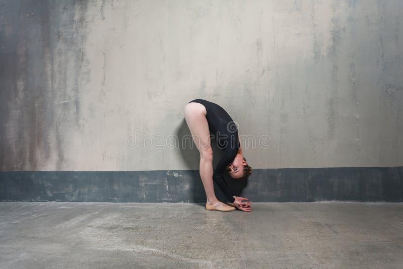 Profile view femininity dancer in fold. Studio shot, gray background stock photos