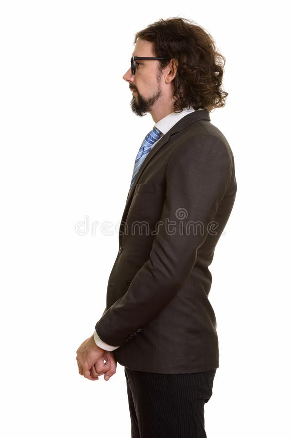 Profile view of handsome Caucasian businessman standing stock image