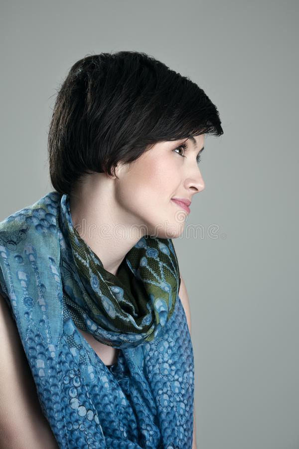 Profile view headshot of pretty short hair brunette smiling looking up stock images