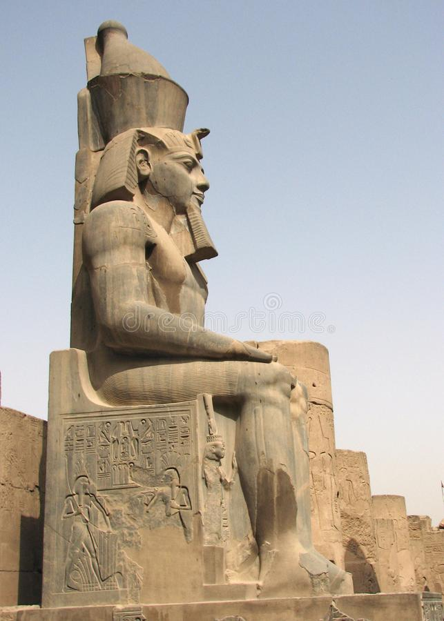 Ramses II at the entrance to the Temple of Luxor, Egypt. Profile view of the Ramses II pylon at the entrance to the Temple of Luxor, Egypt royalty free stock photo