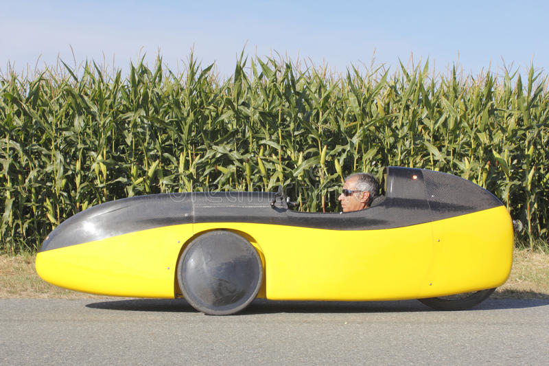 Profile View of a Recumbent Bicycle. A profile view of a man sitting in a recumbent bike or bicycle car stock photos