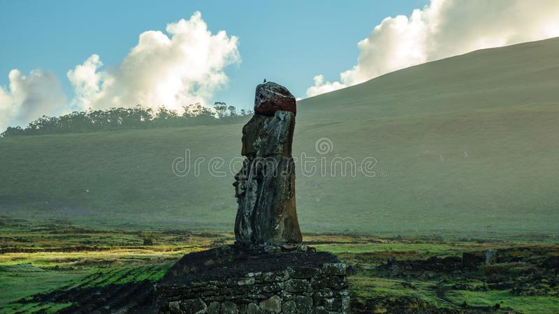 Profile view at sunrise of Ahu Tongariki. Moai platform with mist in the background royalty free stock photos