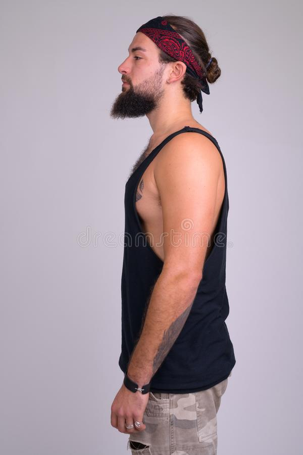 Profile view of young bearded handsome rebellious man royalty free stock photo
