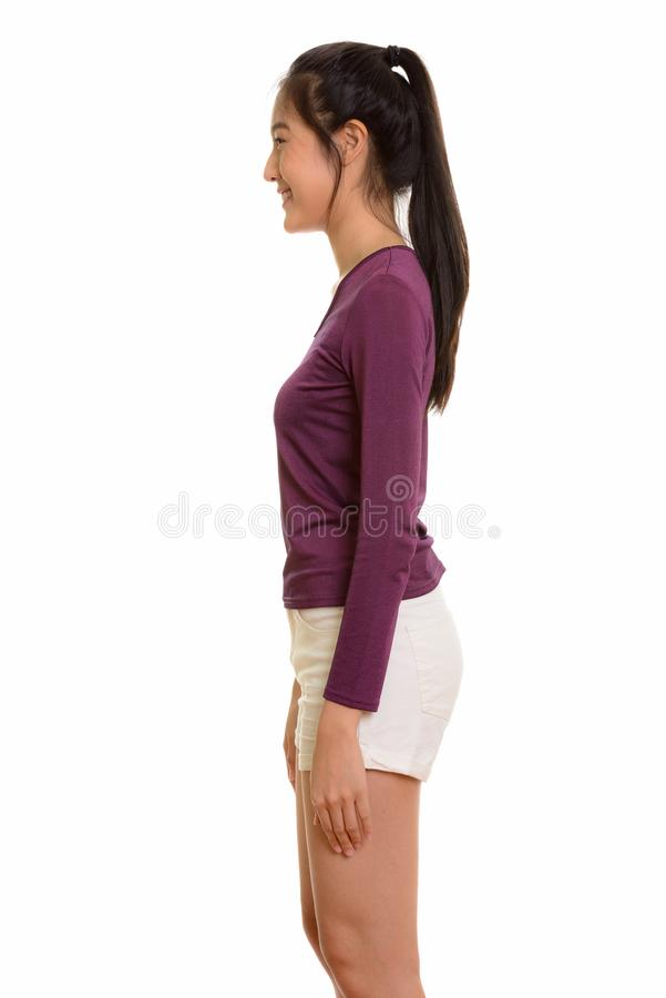 Profile view of young happy Asian teenage girl smiling stock photography