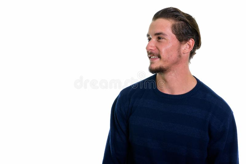 Profile view of young happy man smiling and thinking isolated ag stock photo