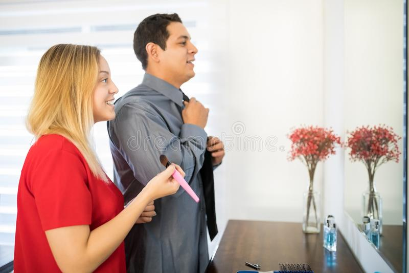 Young couple getting ready for work royalty free stock photo