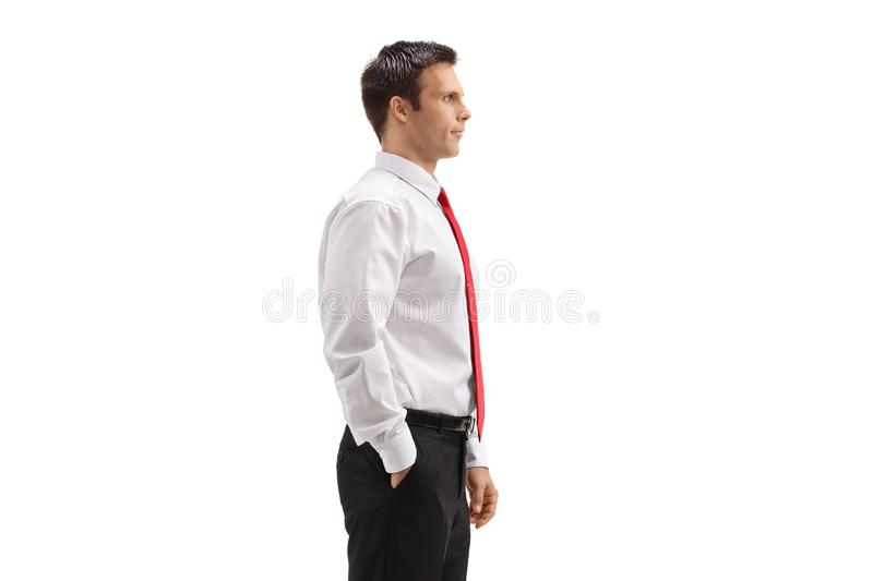 Profile of a young businessman standing stock photos