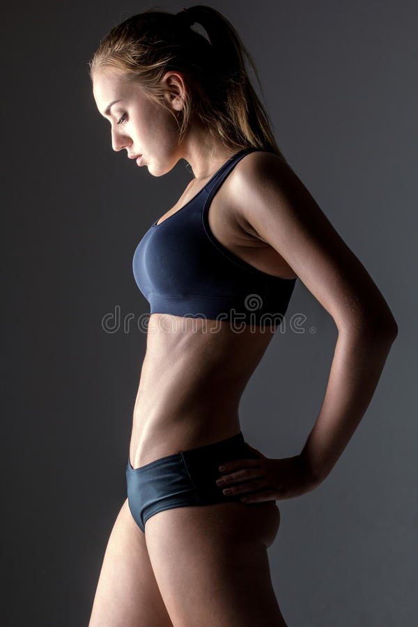 Profile of young fitness woman. Profile of attractive fitness woman, trained female body, lifestyle portrait, caucasian model royalty free stock photo
