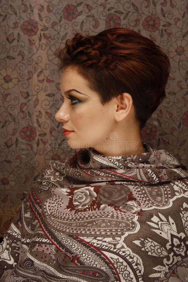 Profile Of A Young Woman On Fabric Background Stock Images