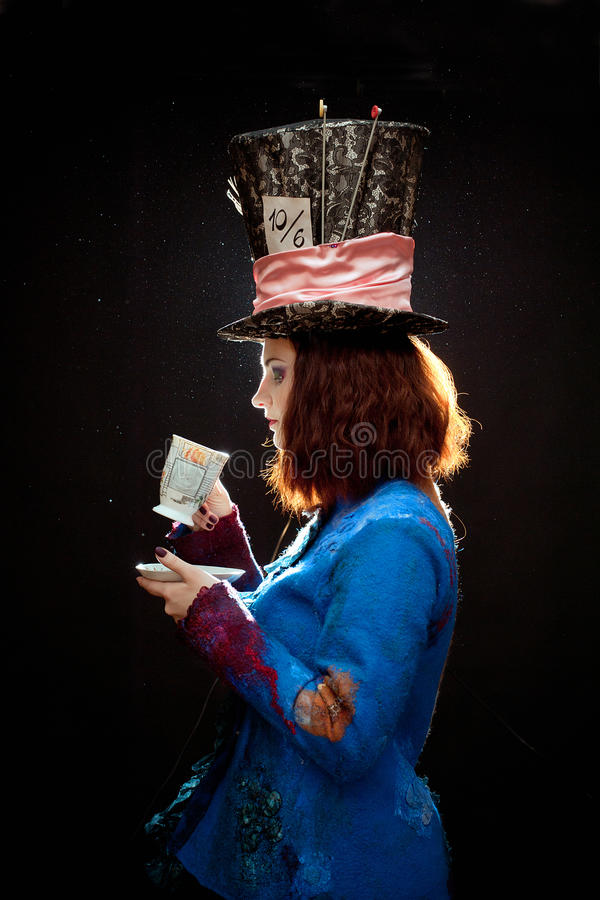 Profile of young woman in the similitude of the Hatter stock photo