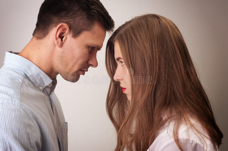 Angry couple looking at each other close royalty free stock photos