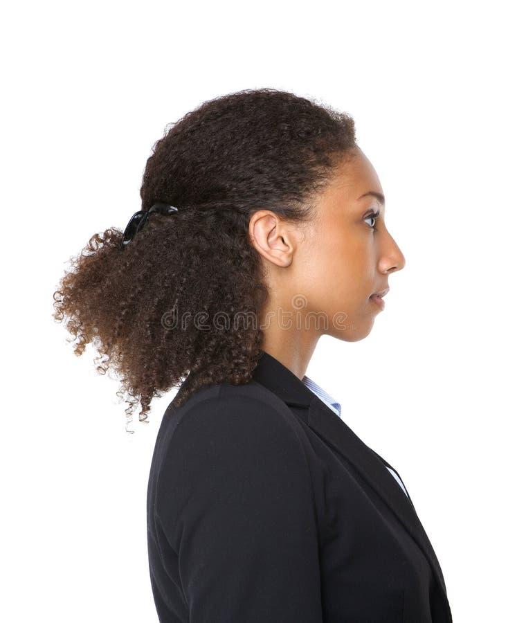 Profilez le portrait d'une jeune femme noire d'affaires photos stock