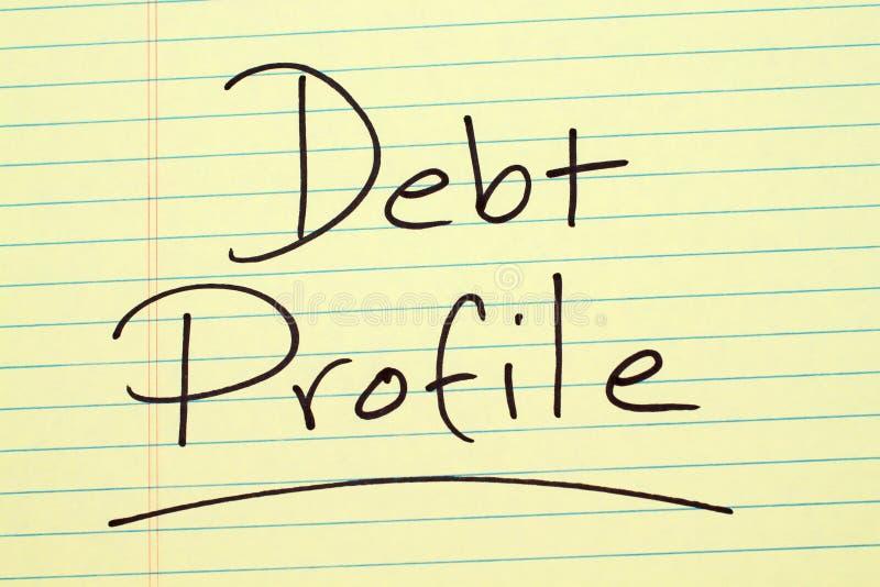 Profilo di debito su un blocco note giallo immagine stock libera da diritti