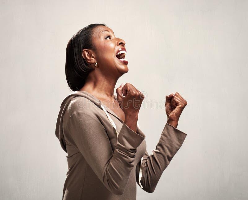 Profilo sorpreso felice della donna di colore immagini stock libere da diritti