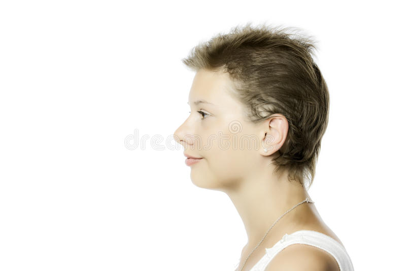 Profilowy widok młoda ładna dziewczyna, odizolowywający na białym backgroun fotografia stock