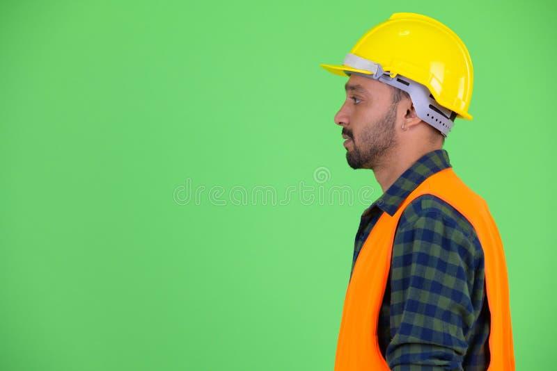 Profilowy widok młody brodaty Perski mężczyzny pracownik budowlany obraz royalty free