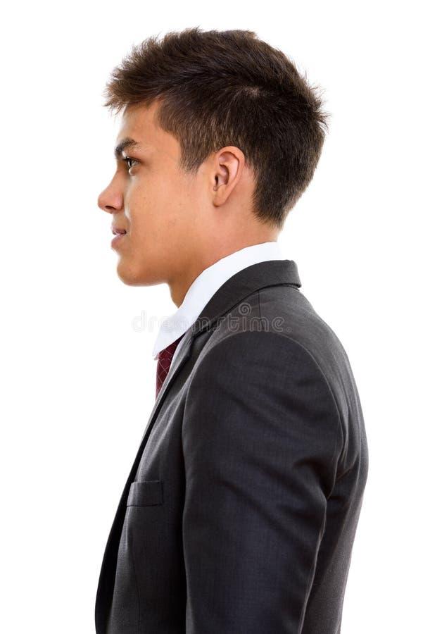 Profilsiktsstående av den unga stiliga affärsmannen royaltyfria foton