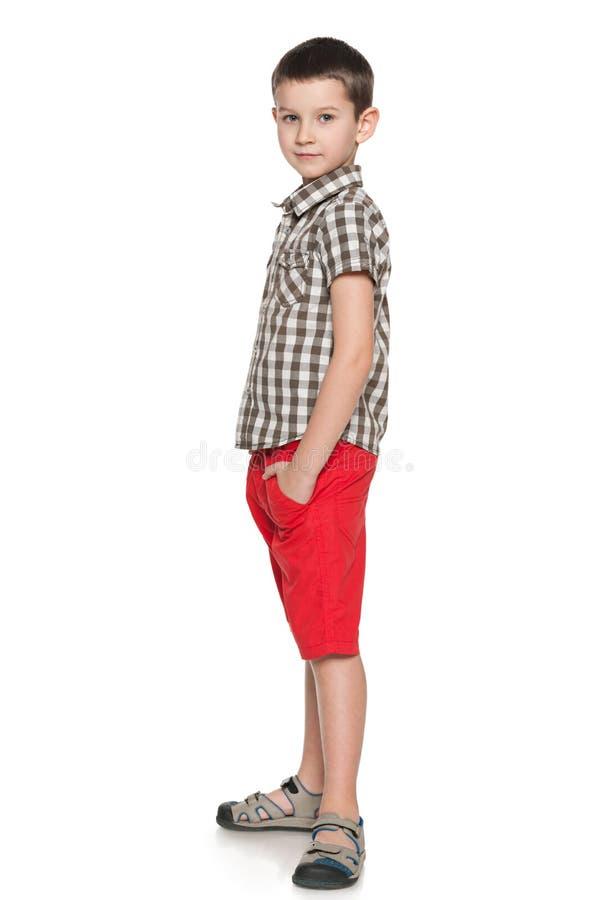 Profilstående av en modebarnpojke fotografering för bildbyråer