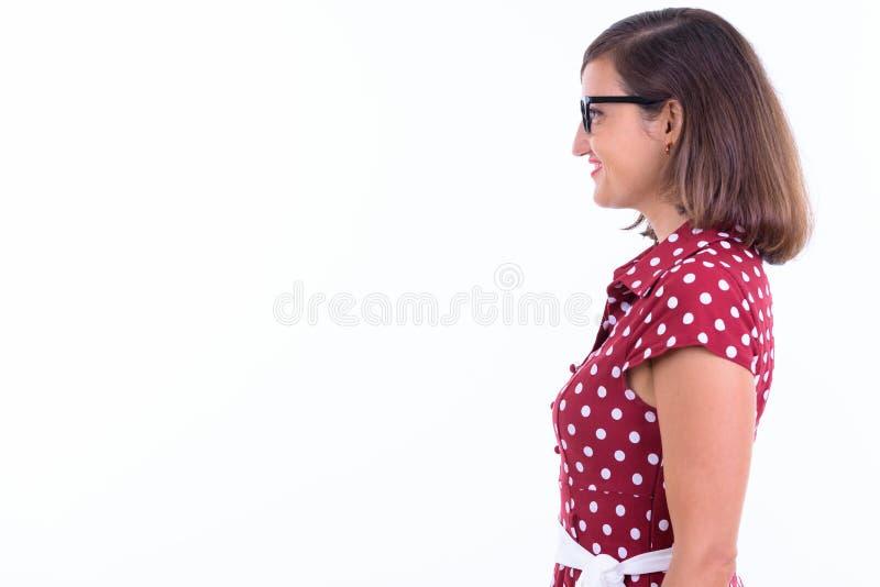 Profilvy av en lycklig vacker kvinna med glasögon som ler royaltyfri foto