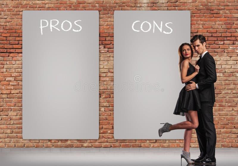 Profissionais - e - contra em um relacionamento imagem de stock royalty free
