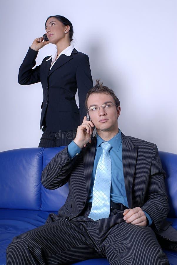 Profissionais em telefones de pilha fotos de stock royalty free