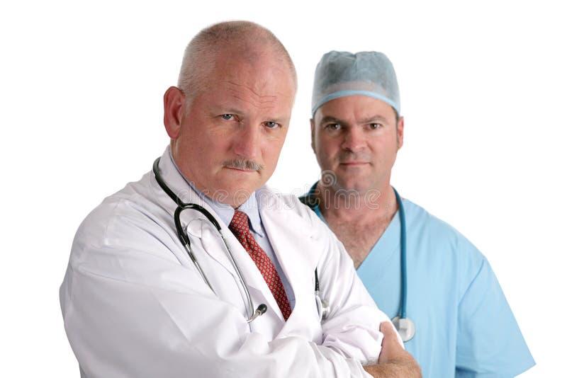 Profissionais médicos sérios fotografia de stock