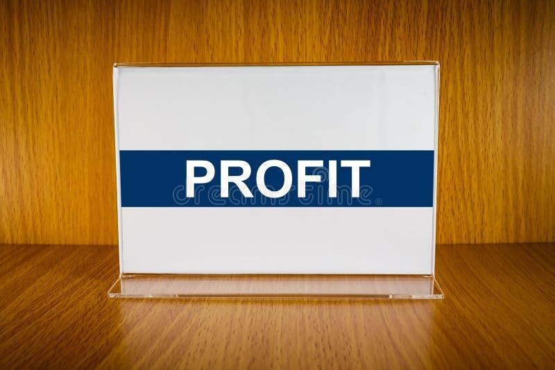 Profit on Acrylic card holder stock photo