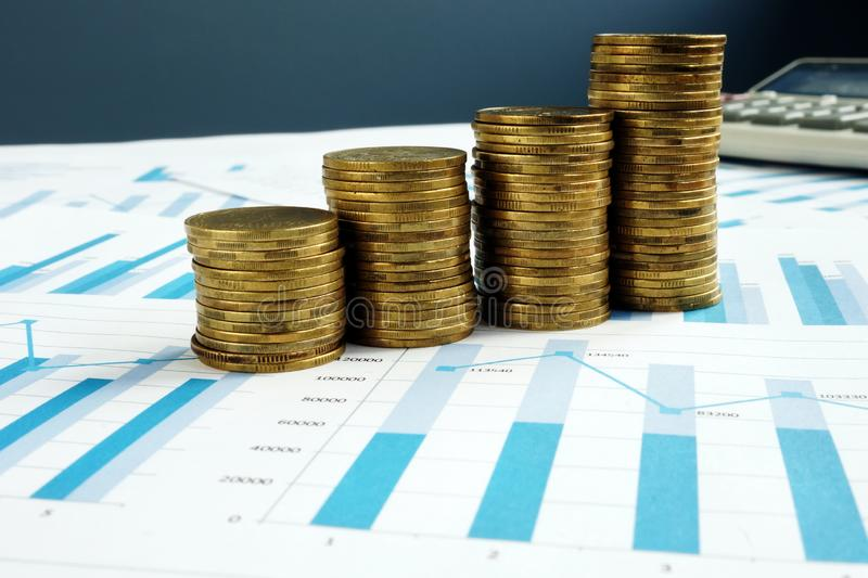 Profit Growth. Stacks of coins and business documents. Investment fund royalty free stock photography