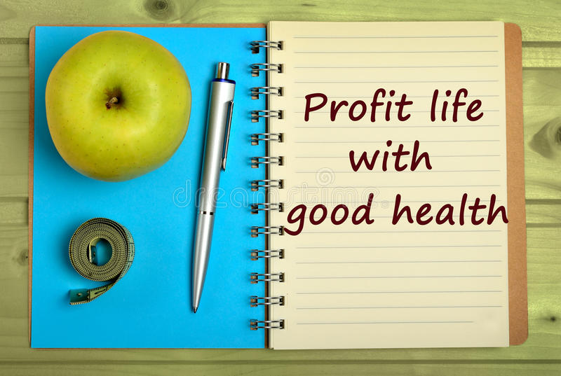 Profit life with a good health. Words on notebook royalty free stock images