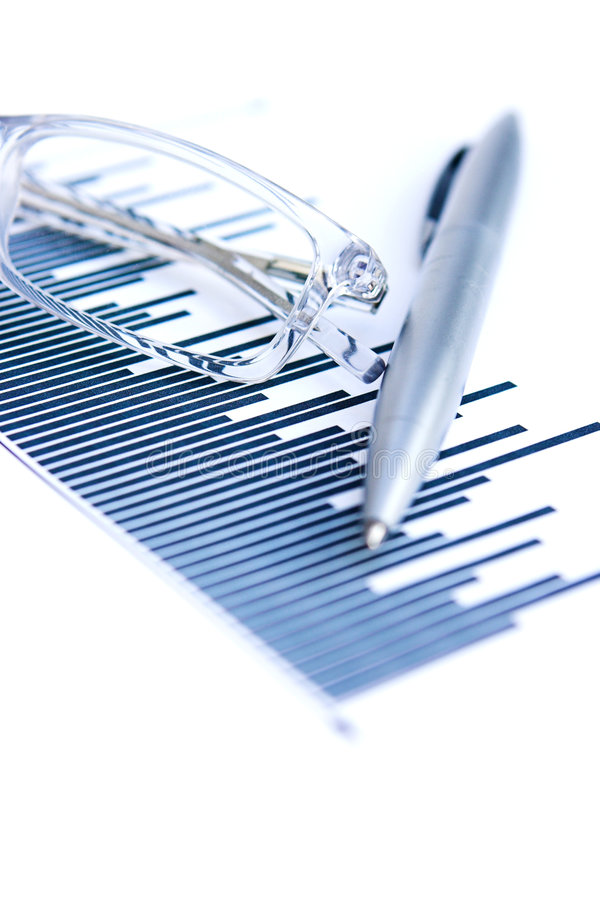 Profit & loss. Business style graph with pen & glasses - shallow depth of field stock images