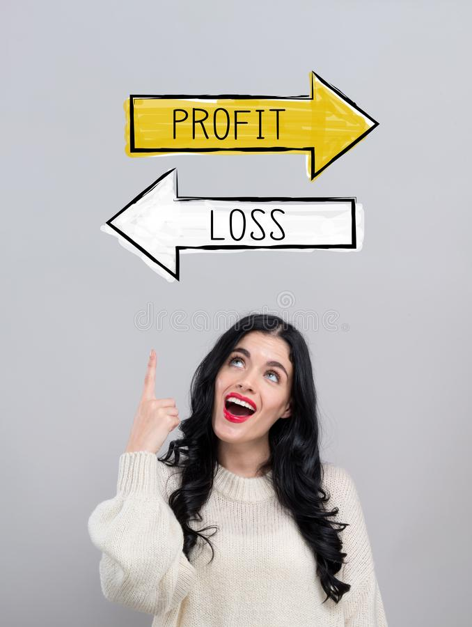 Profit or loss with happy young woman royalty free stock photo