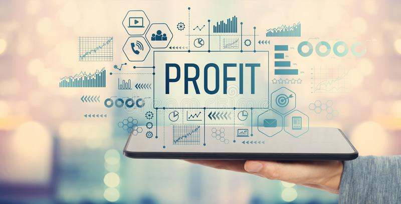 Profit with tablet computer. Profit with man holding a tablet computer stock image