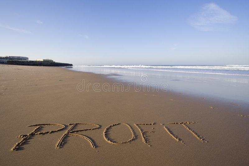Profit word. The word profit in the sand royalty free stock photography