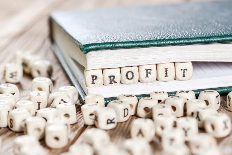 Profit word written on a wooden block. royalty free stock photo