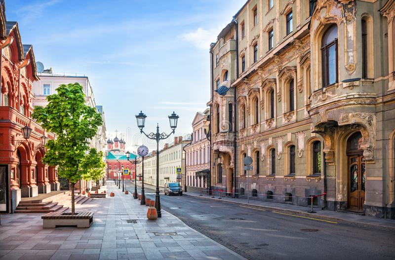 Profitable House Terentyev in Petrovsky Lane. In Moscow and the Theater of Nations opposite. In the distance - the temple of the Petrovsky monastery royalty free stock images