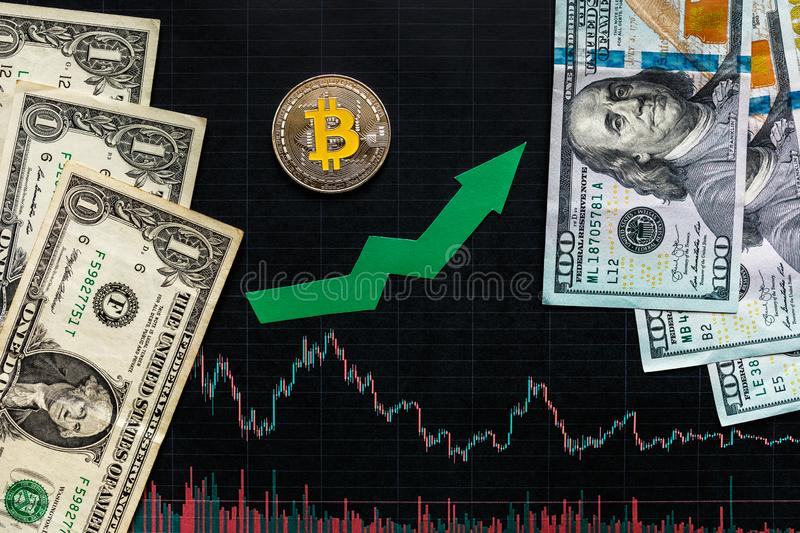 Profitable investment of virtual money bitcoin. Green arrow and silver Bitcoin on black paper forex chart index rating go up on stock photos