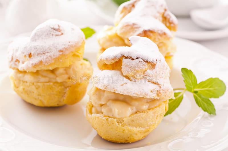 Profiteroles. Stuffed with pastry cream royalty free stock images