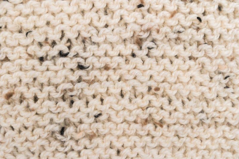 Progettazione del maglione di inverno Bege che tricotta il fondo di struttura della lana Struttura lavorata a maglia del tessuto  fotografie stock