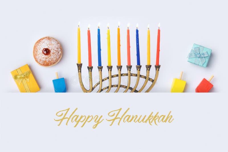 Progettazione ebrea dell'insegna di Chanukah di festa con menorah immagine stock