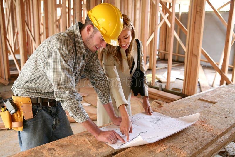 Progettista domestico con il costruttore domestico immagine stock
