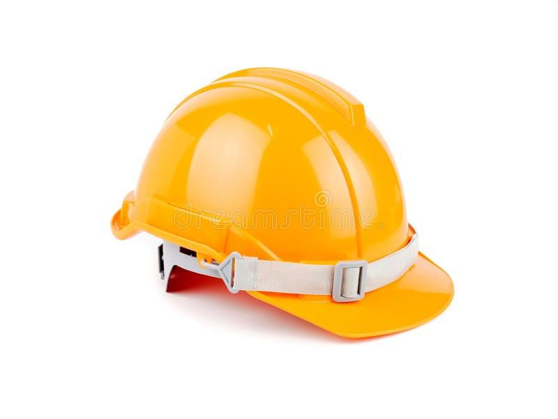 Progetto di sicurezza di concetto casco di sicurezza o del casco arancio di plastica della costruzione degli operai come ingegner immagine stock