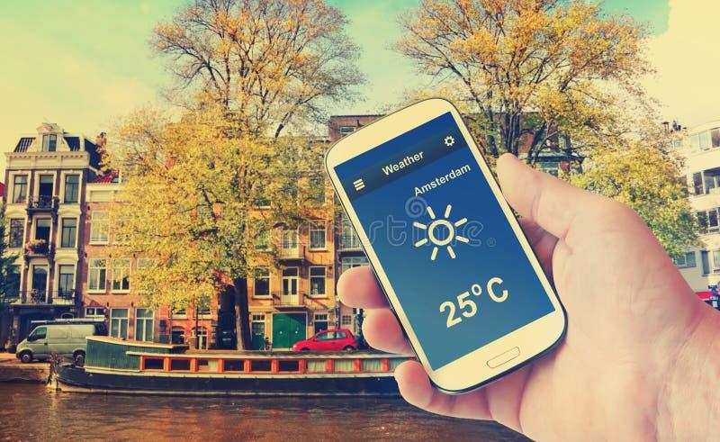 Prognoza pogody Kanałowy pogodny pejzaż miejski amsterdam holandie obraz royalty free